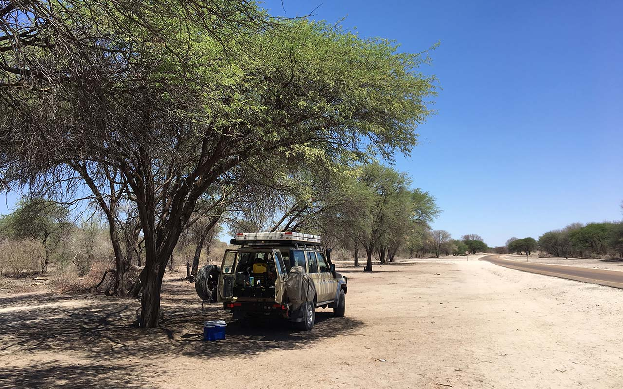 Keeping it safe with a coffee break and a leg-stretch near Shakawe, Botswana