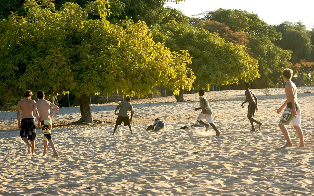 Football on the beach at Norman Carr's Cottages, Malawi