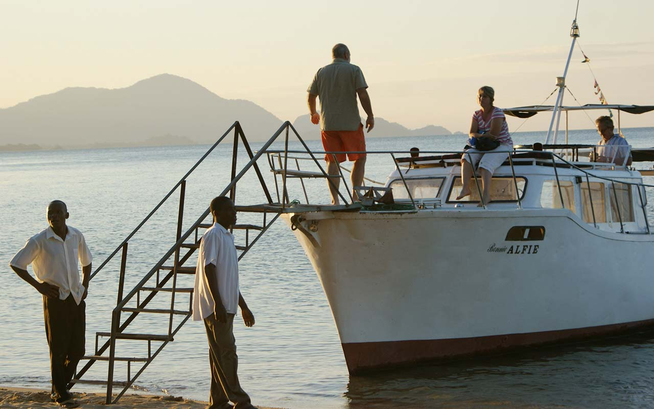 All aboard the Alfie at Norman Carr's Cottages, Malawi