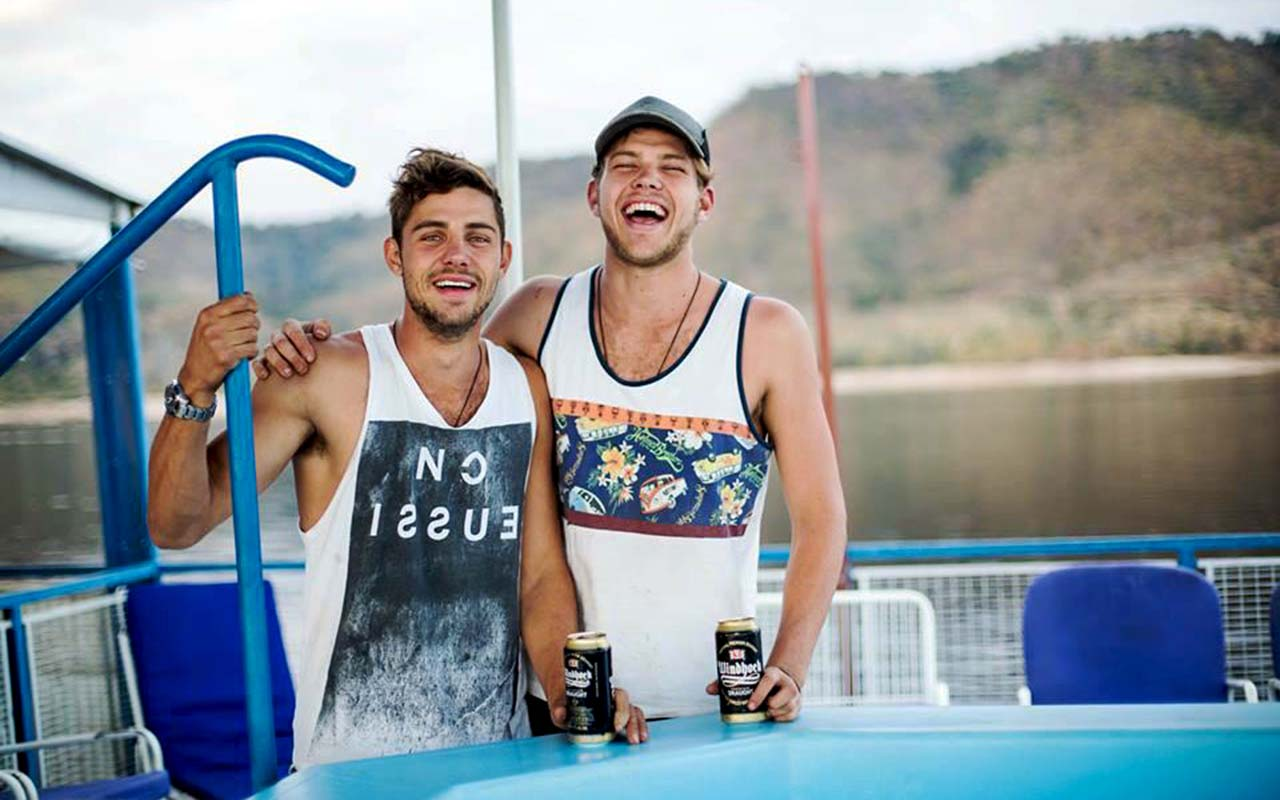 The brothers having a fun moment on a houseboat on Lake Kariba